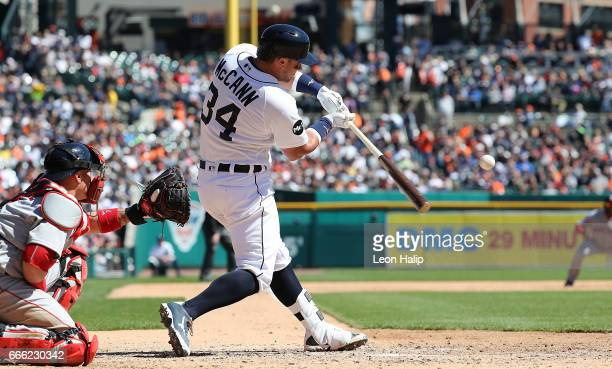 James McCann of the Detroit Tigers hits a solo home run to left field during the fifth inning of the game against the Boston Red Sox on April 8 2017...