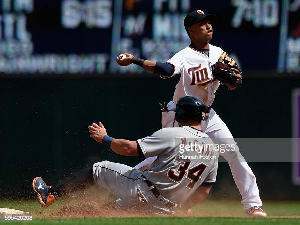 James McCann of the Detroit Tigers is out at second base as Jorge Polanco of the Minnesota Twins turns a double play during the ninth inning of the...