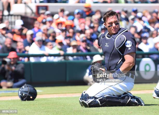 James McCann of the Detroit Tigers looks on during the Spring Training game against the Atlanta Braves at Publix Field at Joker Marchant Stadium on...