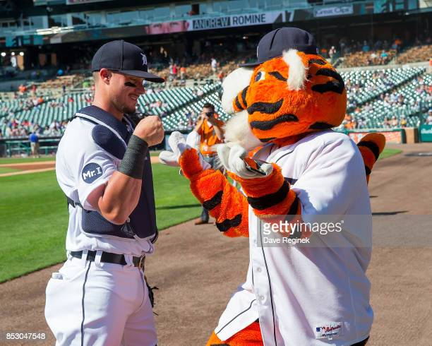 James McCann of the Detroit Tigers pounds fist with Paws before a MLB game against the Minnesota Twins at Comerica Park on September 24 2017 in...