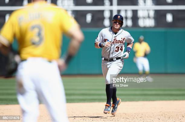 James McCann of the Detroit Tigers rounds the bases after hitting a tworun home run in the sixth inning against the Oakland Athletics at Oakland...
