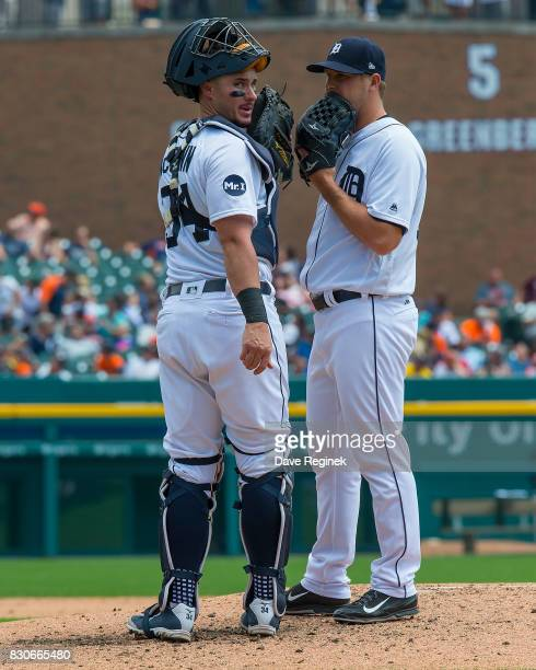 James McCann of the Detroit Tigers talks to Warwick Saupold on a video review during a MLB game against the Pittsburgh Pirates at Comerica Park on...