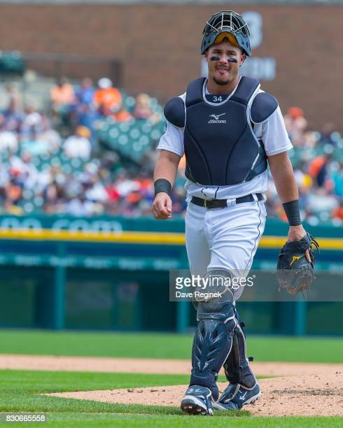 James McCann of the Detroit Tigers walks back to the batters box during a MLB game against the Pittsburgh Pirates at Comerica Park on August 10 2017...