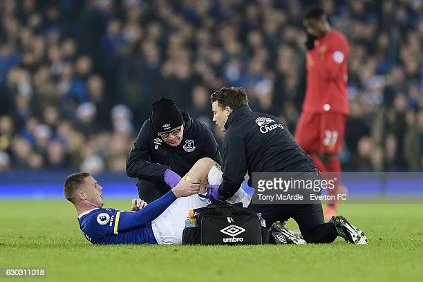 James McCarthy is treated by the Everton medical staff during the Barclays Premier League match between Everton and Liverpool at Goodison Park on...