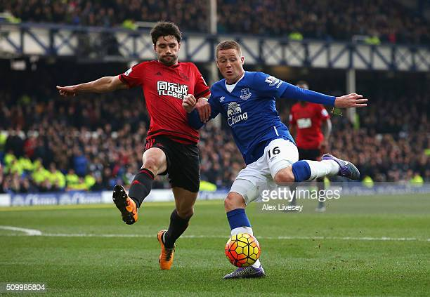 James McCarthy of Everton and Claudio Yacob of West Bromwich Albion compete for the ball during the Barclays Premier League match between Everton and...