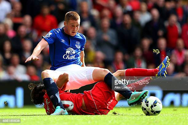 James McCarthy of Everton and Lazar Markovic of Liverpool battle for the ball during the Barclays Premier League match between Liverpool and Everton...