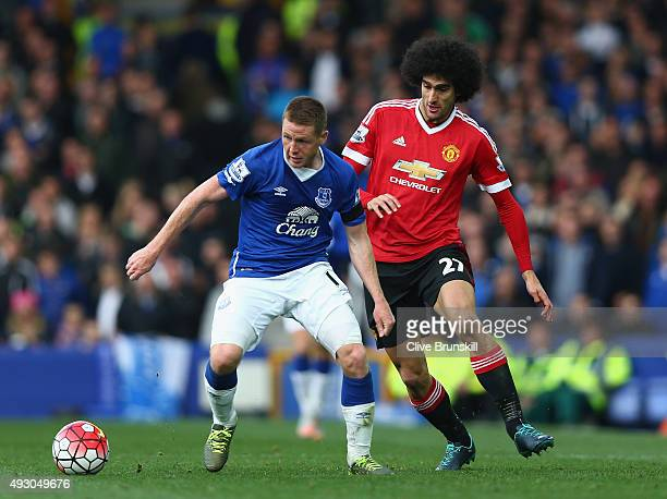 James McCarthy of Everton and Marouane Fellaini of Manchester United compete for the ball during the Barclays Premier League match between Everton...