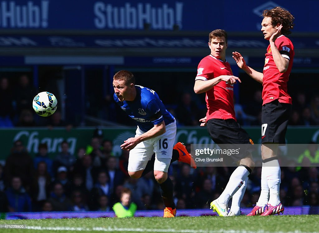 <a gi-track='captionPersonalityLinkClicked' href=/galleries/search?phrase=James+McCarthy+-+Soccer+Player&family=editorial&specificpeople=8984734 ng-click='$event.stopPropagation()'>James McCarthy</a> of Everton (16) beats <a gi-track='captionPersonalityLinkClicked' href=/galleries/search?phrase=Paddy+McNair&family=editorial&specificpeople=13607424 ng-click='$event.stopPropagation()'>Paddy McNair</a> (C) and <a gi-track='captionPersonalityLinkClicked' href=/galleries/search?phrase=Daley+Blind&family=editorial&specificpeople=5566498 ng-click='$event.stopPropagation()'>Daley Blind</a> of Manchester United to score their first goal during the Barclays Premier League match between Everton and Manchester United at Goodison Park on April 26, 2015 in Liverpool, England.