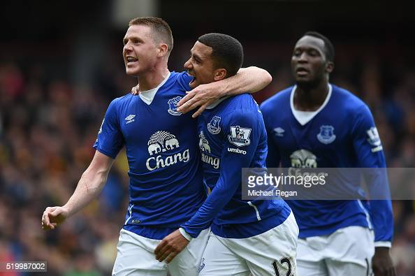 James McCarthy of Everton celebrates scoring his team's first goal with his team mate Aaron Lennon during the Barclays Premier League match between...