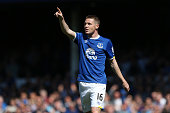 James McCarthy of Everton celebrates scoring his team's first goal during the Barclays Premier League match between Everton and Norwich City at...