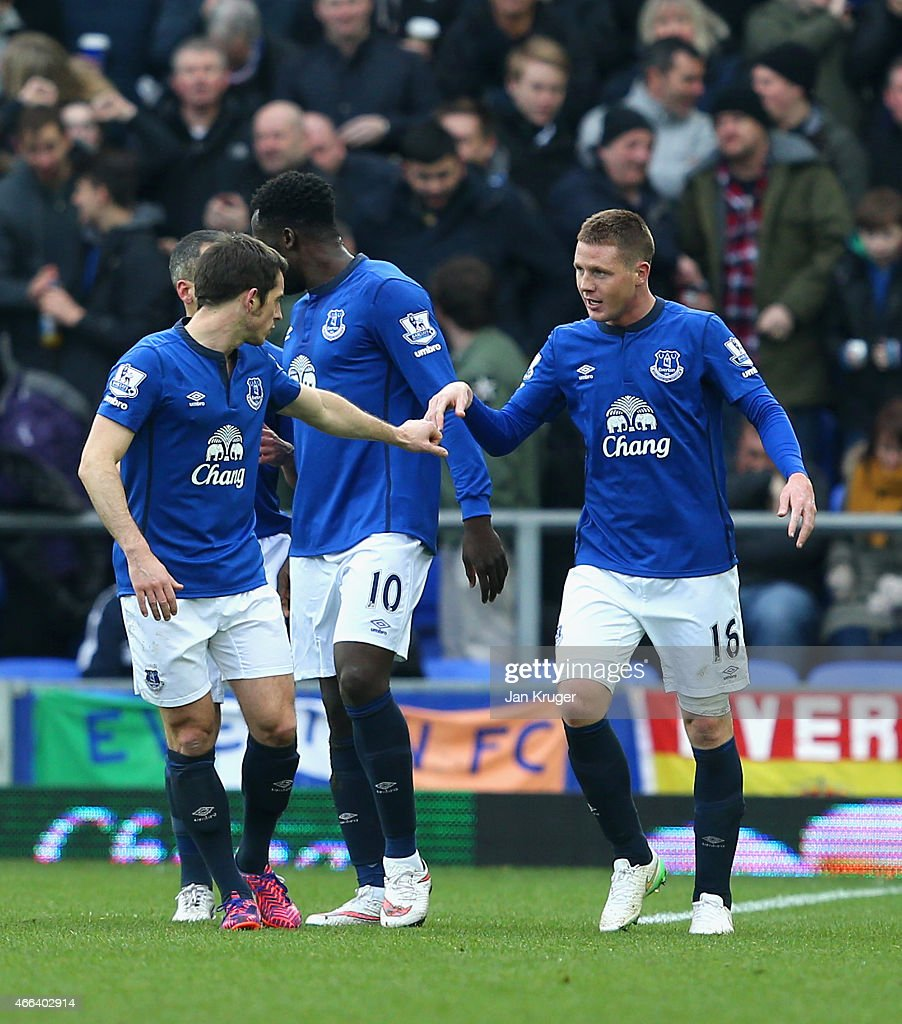 <a gi-track='captionPersonalityLinkClicked' href=/galleries/search?phrase=James+McCarthy+-+Soccer+Player&family=editorial&specificpeople=8984734 ng-click='$event.stopPropagation()'>James McCarthy</a> of Everton (R) celebrates scoring the opening goal with <a gi-track='captionPersonalityLinkClicked' href=/galleries/search?phrase=Leighton+Baines&family=editorial&specificpeople=682452 ng-click='$event.stopPropagation()'>Leighton Baines</a> of Everton during the Barclays Premier League match between Everton and Newcastle United at Goodison Park on March 15, 2015 in Liverpool, England.