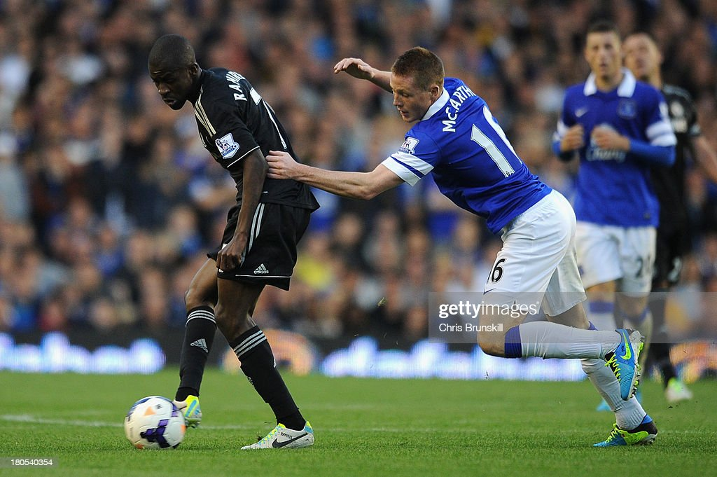 James McCarthy of Everton competes with Ramires of Chelsea during the Barclays Premier League match between Everton and Chelsea at Goodison Park on September 14, 2013 in Liverpool, England.