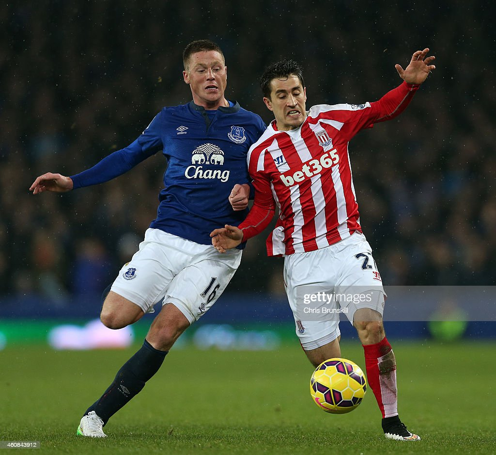 James McCarthy of Everton in action with Bojan Krkic of Stoke City during the Barclays Premier League match between Everton and Stoke City at Goodison Park on December 26, 2014 in Liverpool, England.