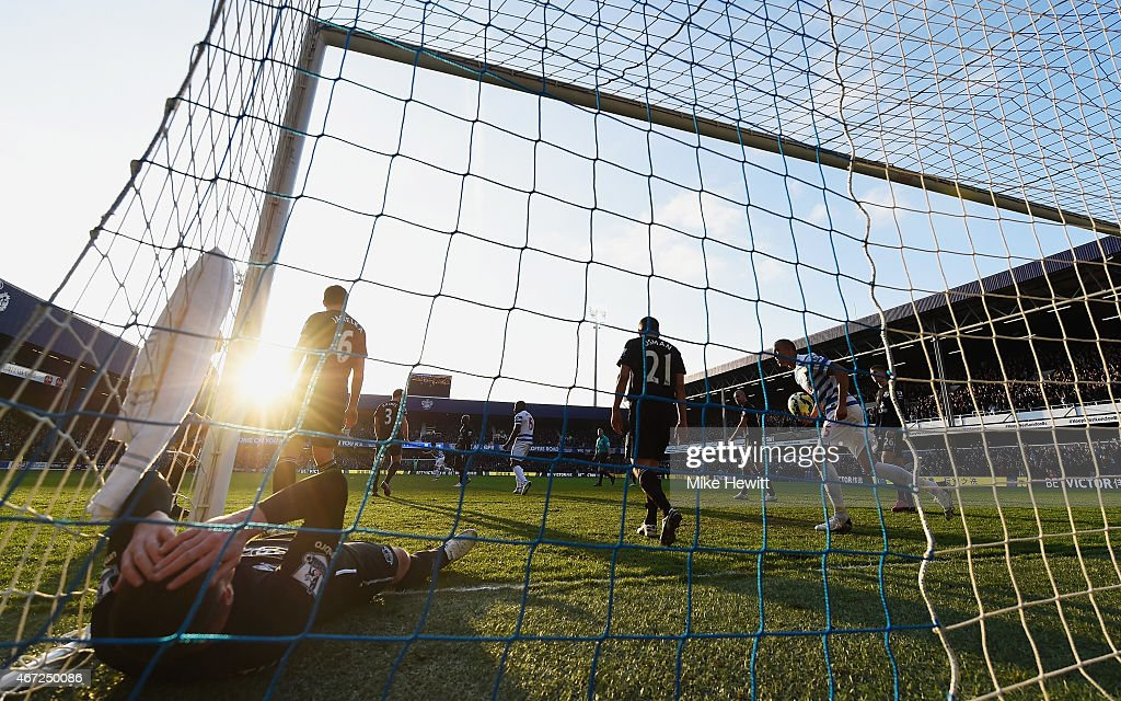 James McCarthy of Everton lies in the goal after the goal scored by Eduardo Vargas of QPR (not in picture) during the Barclays Premier League match between Queens Park Rangers and Everton at Loftus Road on March 22, 2015 in London, England.