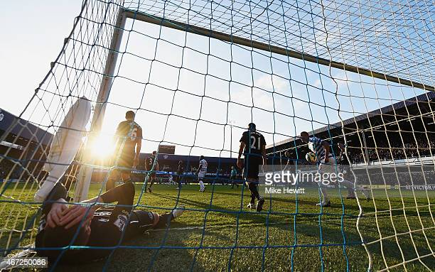 James McCarthy of Everton lies in the goal after the goal scored by Eduardo Vargas of QPR during the Barclays Premier League match between Queens...