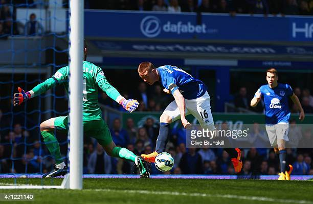 James McCarthy of Everton shoots past goalkeeper David De Gea of Manchester United to score their first goal during the Barclays Premier League match...