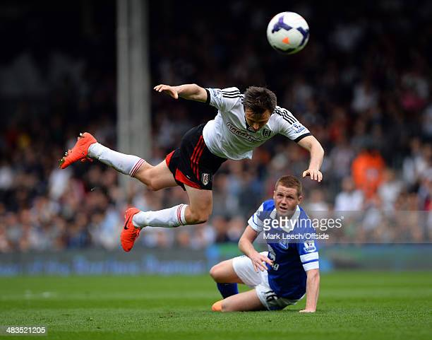 James McCarthy of Everton tackles William Kvist of Fulham during the Barclays Premier League match between Fulham and Everton at Craven Cottage on...