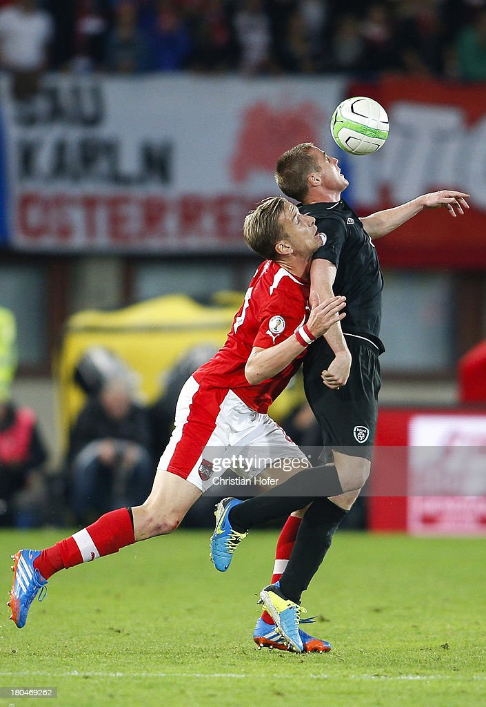 James McCarthy of Ireland (L) challenges Marc Janko of Austria during the FIFA World Cup 2014 Group C qualification match between Austria and the Republic of Ireland at the Ernst Happel Stadium on September 10, 2013 in Vienna, Austria.