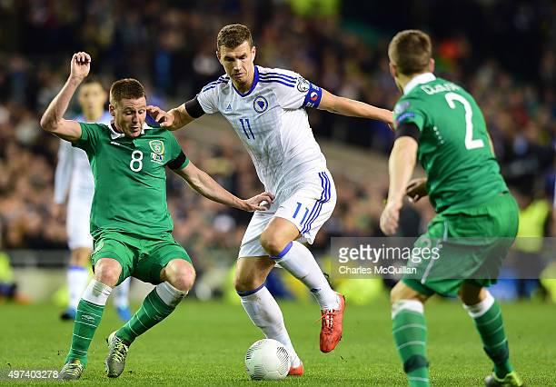 James McCarthy of Republic of Ireland and Edin Dzeko BosniaHerzegovina during the Euro 2016 playoff second leg match at Aviva Stadium on November 16...