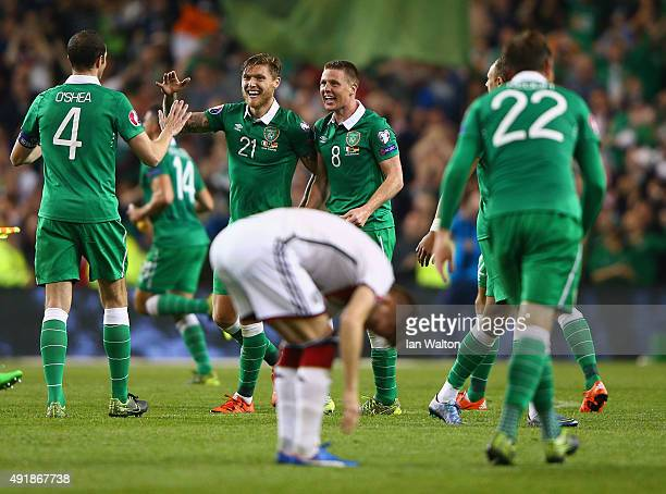 James McCarthy of Republic of Ireland celebrates victory with team mates after the UEFA EURO 2016 Qualifier group D match between Republic of Ireland...