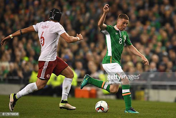 James McCarthy of Republic of Ireland is chased down by Murtaz Daushvili of Georgia during the FIFA 2018 World Cup Group D Qualifier between Republic...