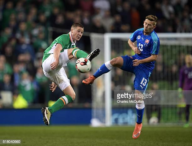 James McCarthy of the Republic of Ireland and Patrik Hrosovsky of Slovakia during the international friendly match between the Republic of Ireland...