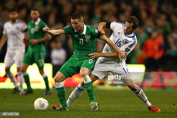 James McCarthy of the Republic of Ireland is challenged by by Senad Lulic of Bosnia and Herzegovina during the UEFA EURO 2016 Qualifier play off...