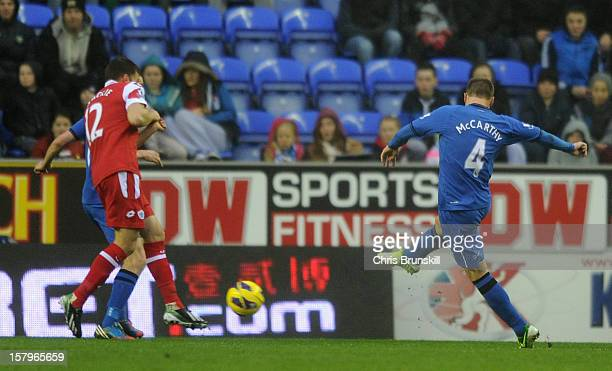 James McCarthy of Wigan Athletic scores the opening goal the Barclays Premier League match between Wigan Athletic and Queens Park Rangers at the DW...