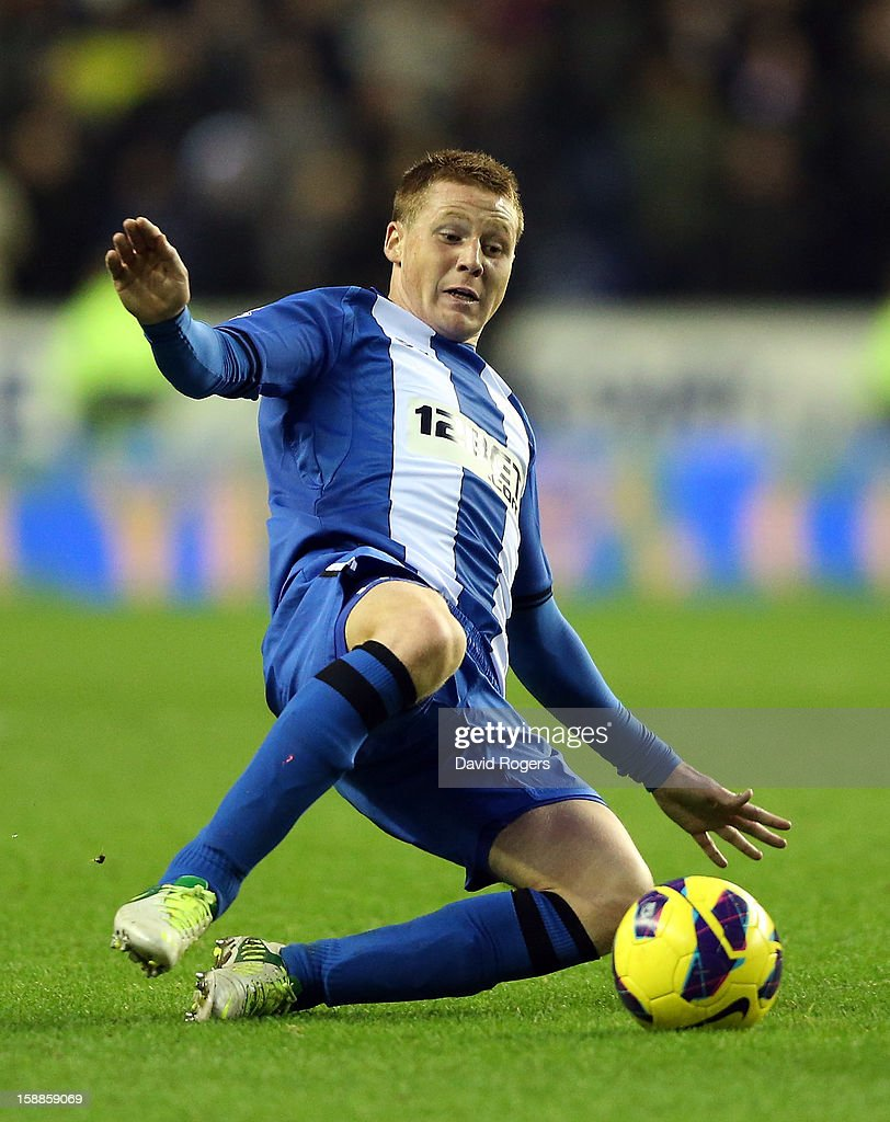 James McCarthy of Wigan controls the ball during the Barclays Premier League match between Wigan Athletic and Manchester United at the DW Stadium on January 1, 2013 in Wigan, England.