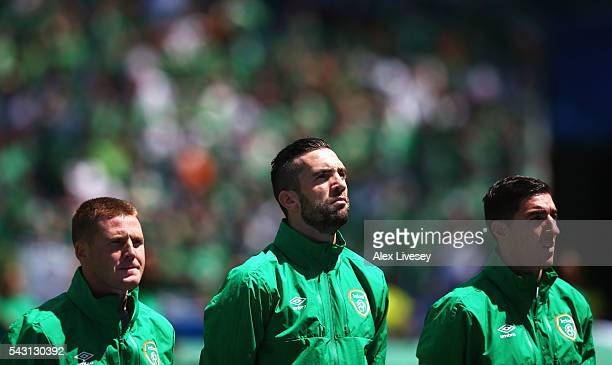 James McCarthy Shane Duffy and Stephen Ward of Republic of Ireland line up for the national anthem prior to the UEFA EURO 2016 round of 16 match...