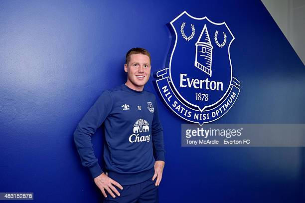 James McCarthy signs a new contract at Everton at Finch Farm on August 6 2015 in Liverpool England