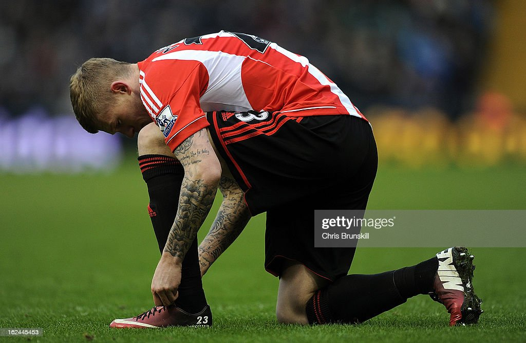 James McClean of Sunderland ties his bootlaces during the Barclays Premier League match between West Bromwich Albion and Sunderland at The Hawthorns on February 23, 2013 in West Bromwich, England.