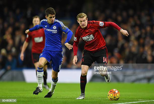 James McClean of West Bromwich Albion and Oscar of Chelsea compete for the ball during the Barclays Premier League match between Chelsea and West...