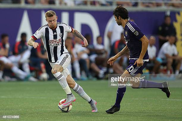 James McClean of West Bromwich Albion controls the ball in front of Kaka of Orlando City SC during an International friendly soccer match between...