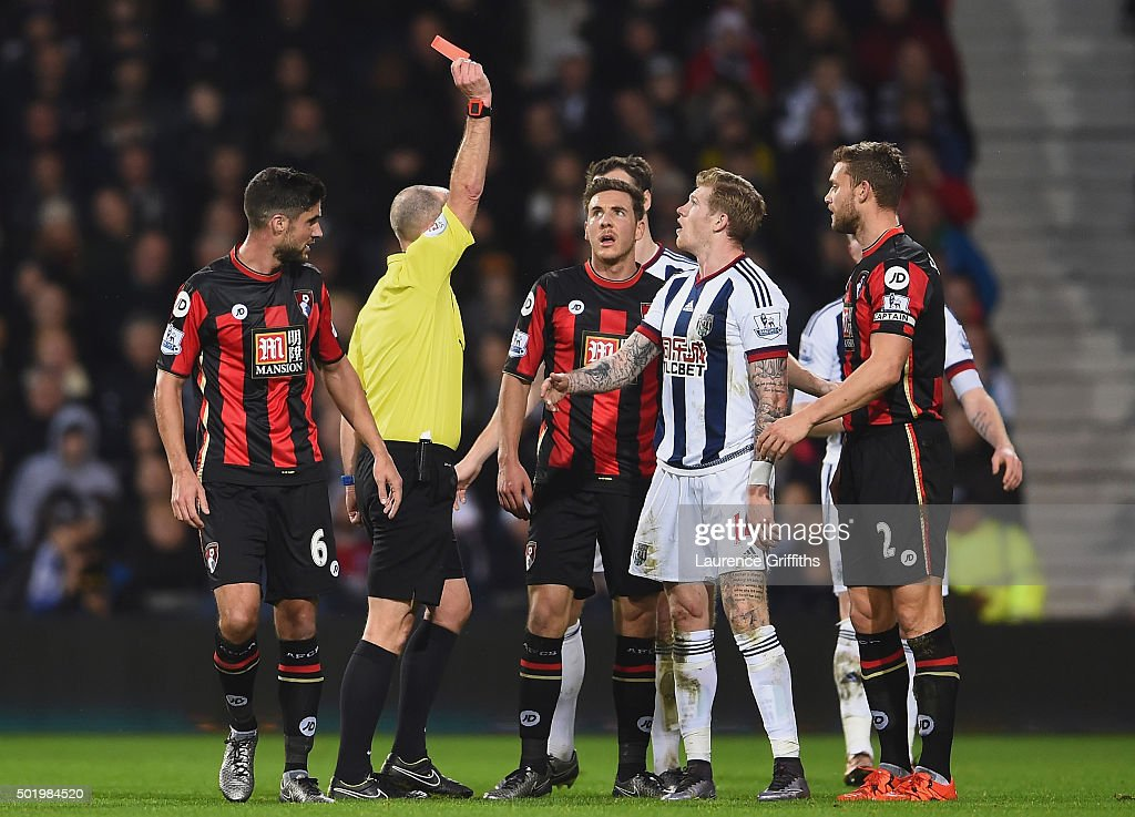 James McClean (3rd R) of West Bromwich Albion is shown a red card by referee Mike Dean (2nd L) after fouling Adam Smith of Bournemouth during the Barclays Premier League match between West Bromwich Albion and A.F.C. Bournemouth at The Hawthorns on December 19, 2015 in West Bromwich, England.