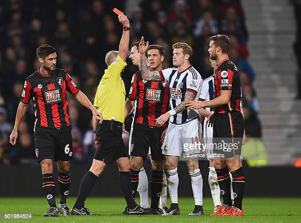 James McClean of West Bromwich Albion is shown a red card by referee Mike Dean after fouling Adam Smith of Bournemouth during the Barclays Premier...