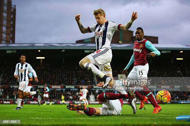 James McClean of West Bromwich Albion is tackled by Carl Jenkinson of West Ham United during the Barclays Premier League match between West Ham...