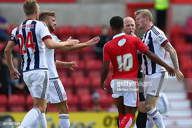James McClean of West Bromwich Albion squares up to Nathan Byrne of Swindon Town during the PreSeason Friendly match between Swindon Town and West...