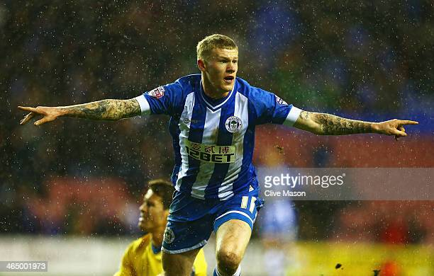 James McClean of Wigan Athletic celebrates his goal during the Budweiser FA Cup fourth round match between Wigan Athletic and Crystal Palace at DW...
