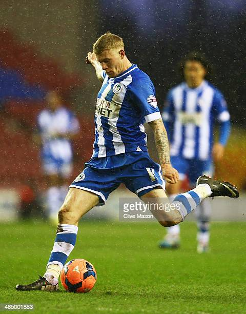James McClean of Wigan Athletic shoots to score his goal during the Budweiser FA Cup fourth round match between Wigan Athletic and Crystal Palace at...