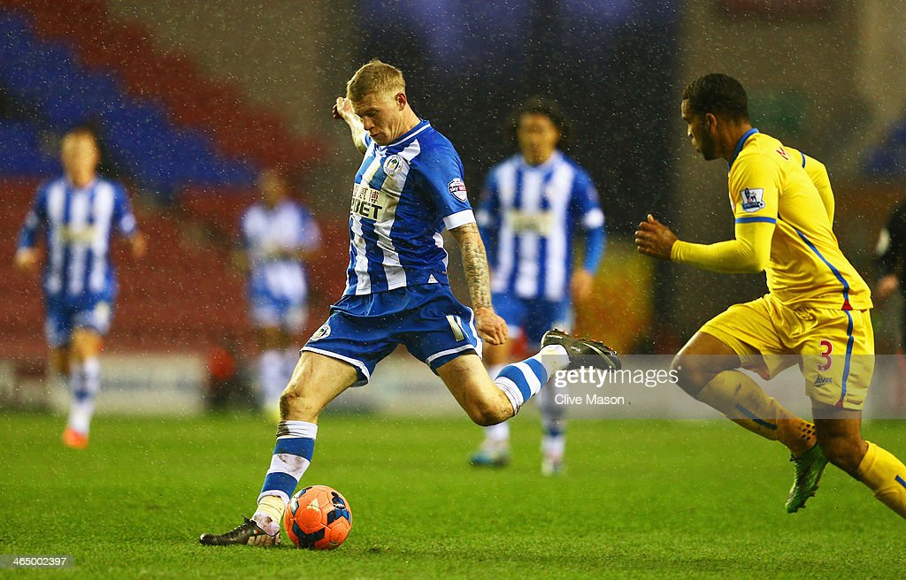 <a gi-track='captionPersonalityLinkClicked' href=/galleries/search?phrase=James+McClean&family=editorial&specificpeople=3699424 ng-click='$event.stopPropagation()'>James McClean</a> of Wigan Athletic shoots to score his goal during the Budweiser FA Cup fourth round match between Wigan Athletic and Crystal Palace at DW Stadium on January 25, 2014 in Wigan, England.