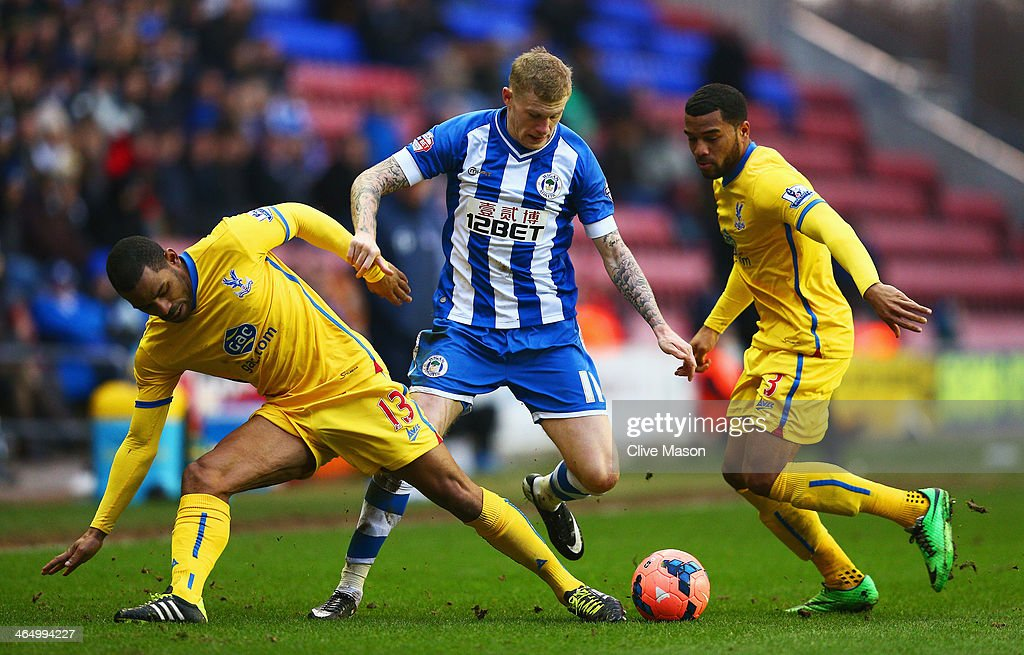 <a gi-track='captionPersonalityLinkClicked' href=/galleries/search?phrase=James+McClean&family=editorial&specificpeople=3699424 ng-click='$event.stopPropagation()'>James McClean</a> of Wigan Athletic takes on Jason Puncheon (L) and <a gi-track='captionPersonalityLinkClicked' href=/galleries/search?phrase=Adrian+Mariappa&family=editorial&specificpeople=661604 ng-click='$event.stopPropagation()'>Adrian Mariappa</a> of Crystal Palace during the Budweiser FA Cup fourth round match between Wigan Athletic and Crystal Palace at DW Stadium on January 25, 2014 in Wigan, England.