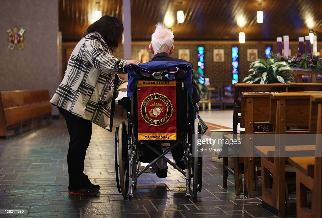 James McCormick is comforted by a neighbor at the St. Charles Catholic Church before a funeral for his longtime partner David Maxwell, 66, who died in Hurricane Sandy floodwaters in the Midland Beach area of Staten Island on December 11, 2012 in New York City. Maxwell was the last of Sandy's victims found on Staten Island, when his body was discovered in his home 11 days after the storm. A Vietnam veteran, he was buried at the Calverton National Cemetery and was accompanied by honor guards from the Catholic War Veterans and the Patriot Guard Riders.