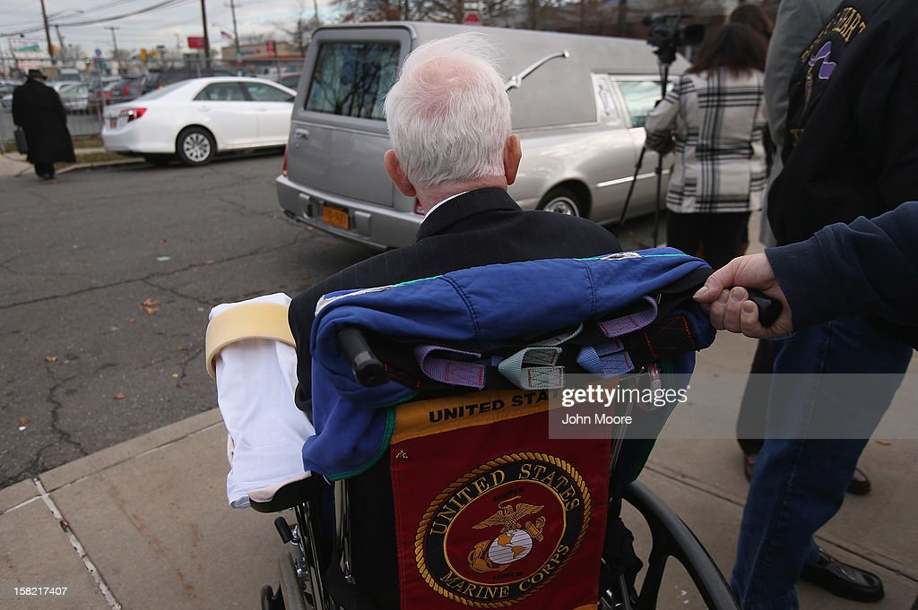 James McCormick, 72, leaves the St. Charles Catholic Church after a funeral for his longtime partner David Maxwell, 66, who died during Hurricane Sandy in the Midland Beach area of Staten Island on December 11, 2012 in New York City. Maxwell was the last of Sandy's victims found on Staten Island, when his body was discovered in his home 11 days after the storm. A Vietnam veteran, he was buried on Long Island at the Calverton National Cemetery and was accompanied by honor guards from the Catholic War Veterans and the Patriot Guard Riders.