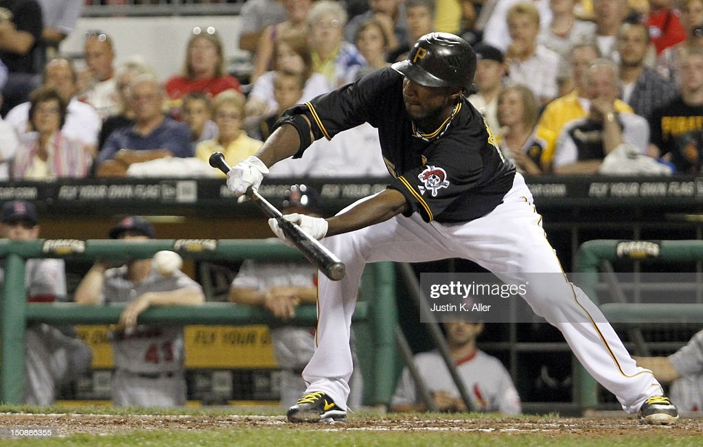 James McDonald #53 of the Pittsburgh Pirates lays down a bunt against the St. Louis Cardinals during the game on August 28, 2012 at PNC Park in Pittsburgh, Pennsylvania.