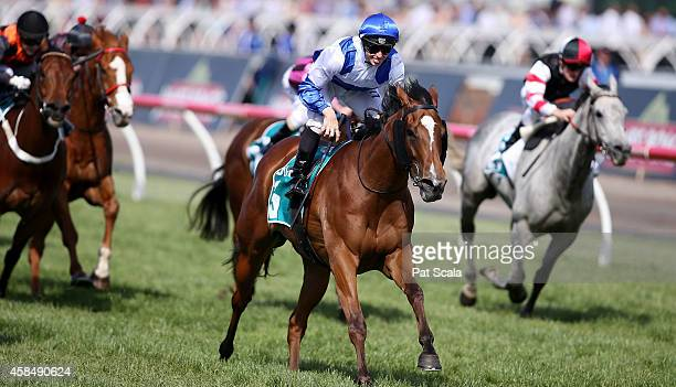 James McDonald riding Atmospherical winning race 7 The Dilmah Earl Grey Stakes on Oaks Day at Flemington Racecourse on November 6 2014 in Melbourne...