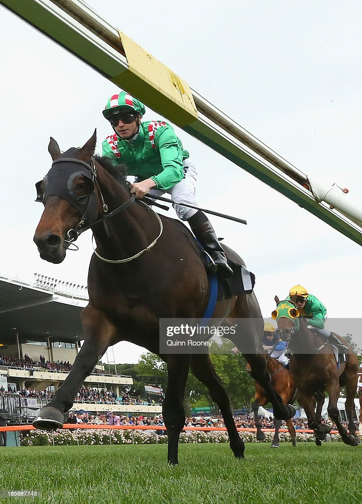 James McDonald riding Savy Nature crosses the line to win the Mitchelton Wines Vase during Cox Plate Day at Moonee Valley Racecourse on October 26, 2013 in Melbourne, Australia.