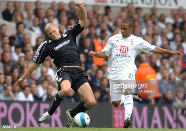 James McEveley Derby County and Wayne Routledge Tottenham Hotspur battle for the ball