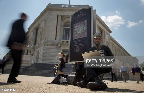 James McGinley uses solar power to run his laptop in front of the Cannon House Office Building on July 17 in Washington DC McGinley is protesting...