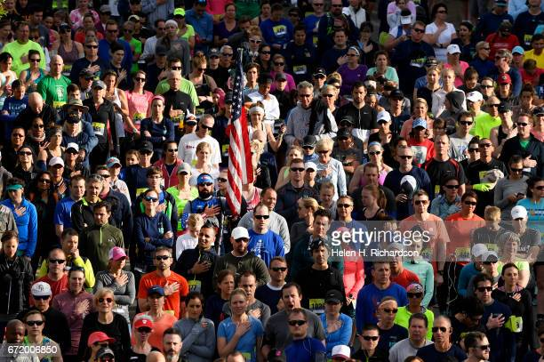 James McGregor of Denver holds and American flag during the singing of the National Anthem before the start of the 35th annual Cherry Creek Sneak 10...